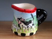 Pitcher with a cow